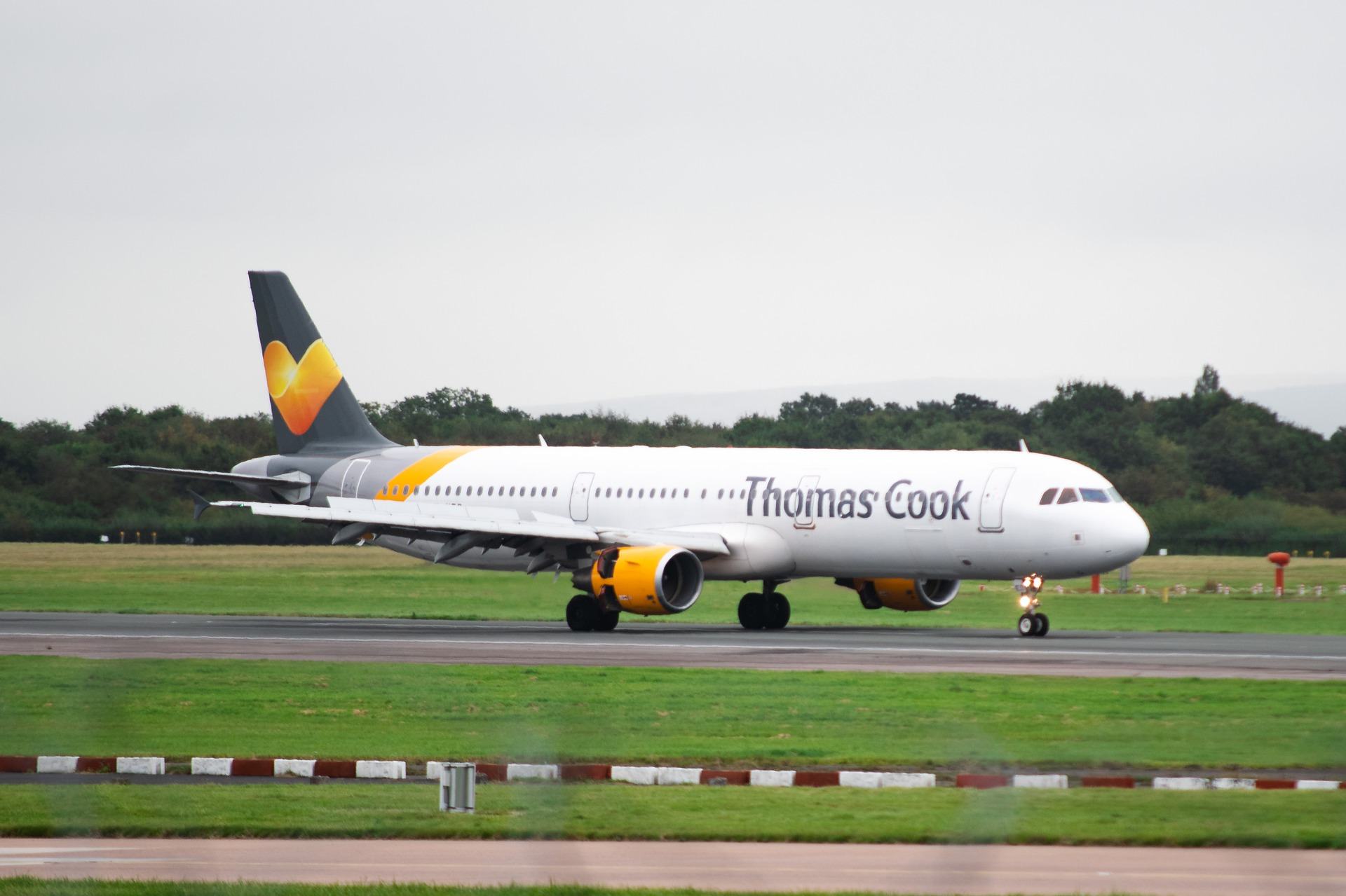 A Thomas Cook plane lands.